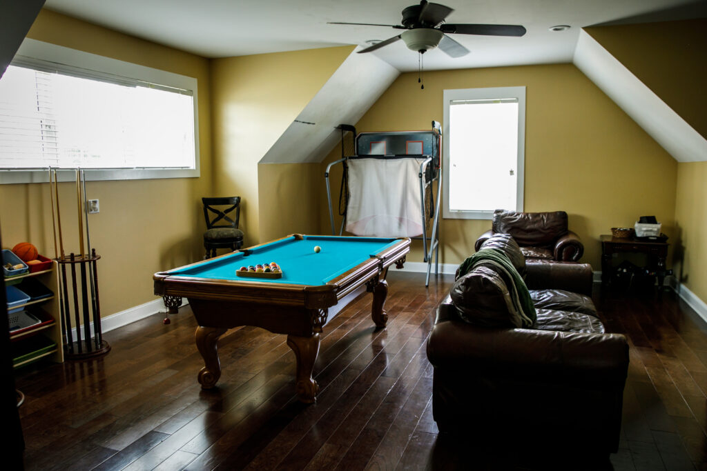 pool table in man cave with hardwood floor