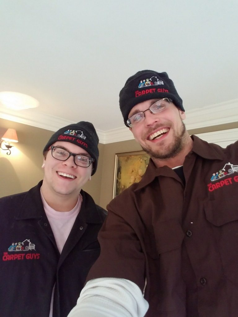 selfie of two installers for The Carpet Guys