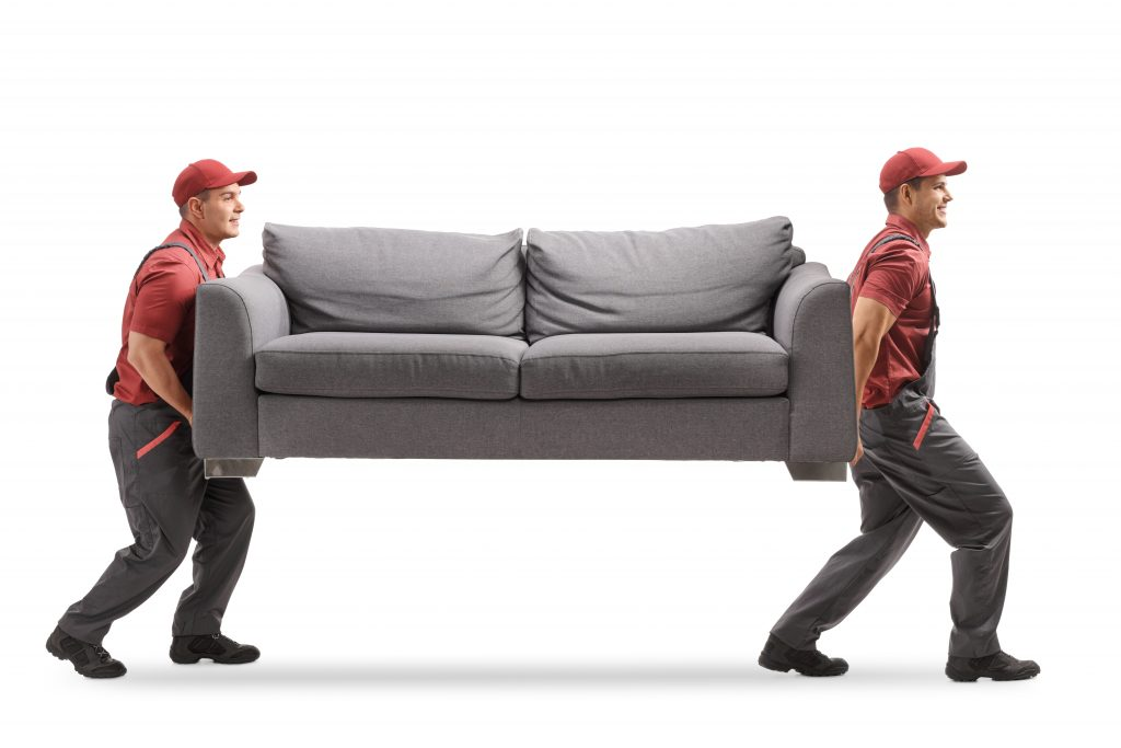 2 carpet guys installers moving a sofa