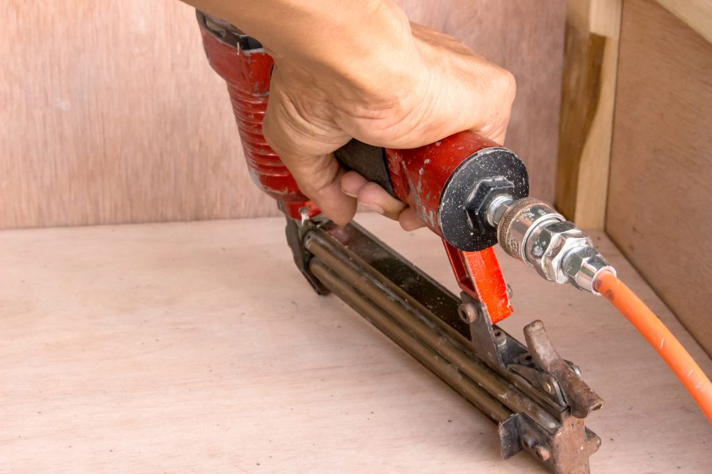 using air compressed nail gun to install hardwood floor