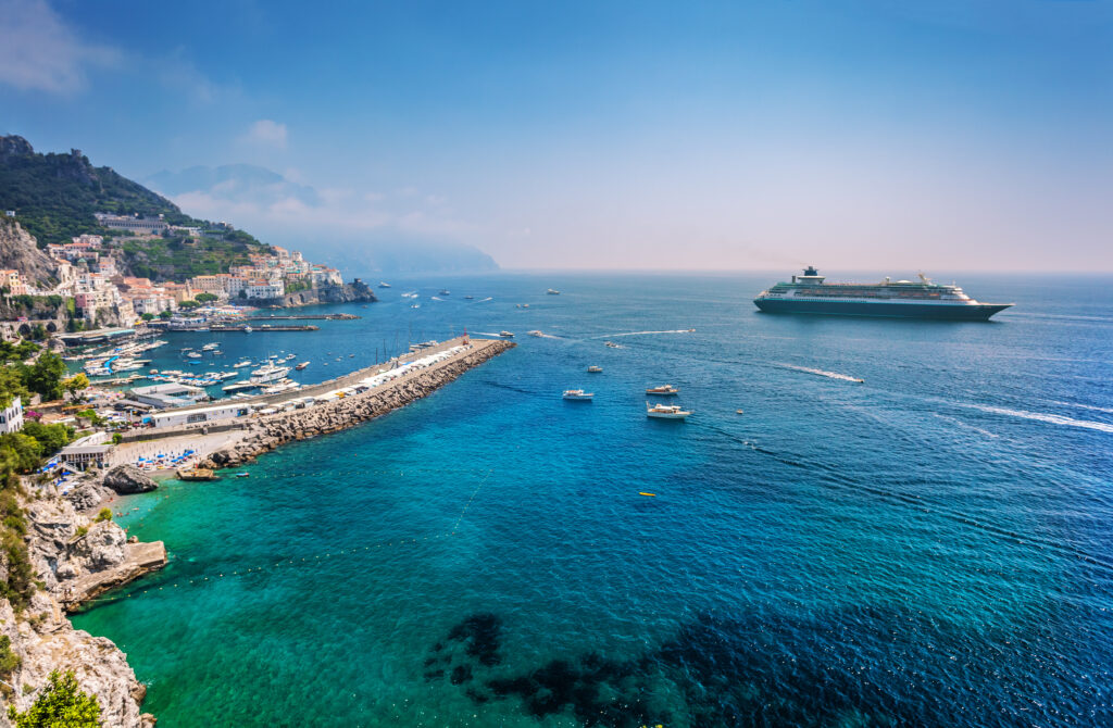 Cruise liner at port in Italy using vacation vouchers