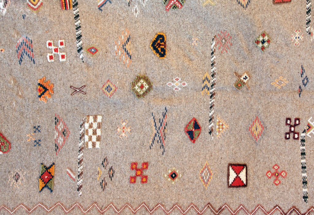Texture of traditional handmade wool carpet with geometric pattern, Morocco, Africa
