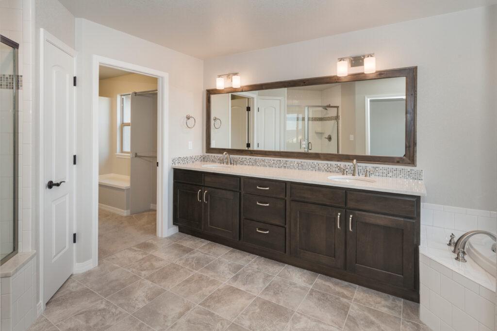 Modern Farm House Bathroom with large marble look lvt